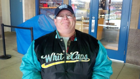 West Michigan Whitecaps super-fan Tom Grey proudly wears his original-issue Whitecaps jacket.