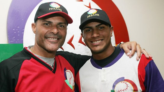 Jose (left), with his son, Jesmuel (right). Photo courtesy of MLB.com)