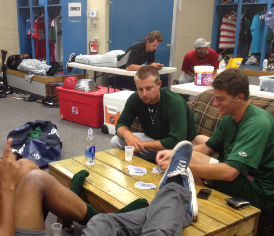 Matt Shepherd, Max Fried and others playing cards in the clubhouse at West Michigan.