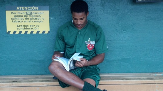 Smith studies his notebook prior to an August 9th game at South Bend.