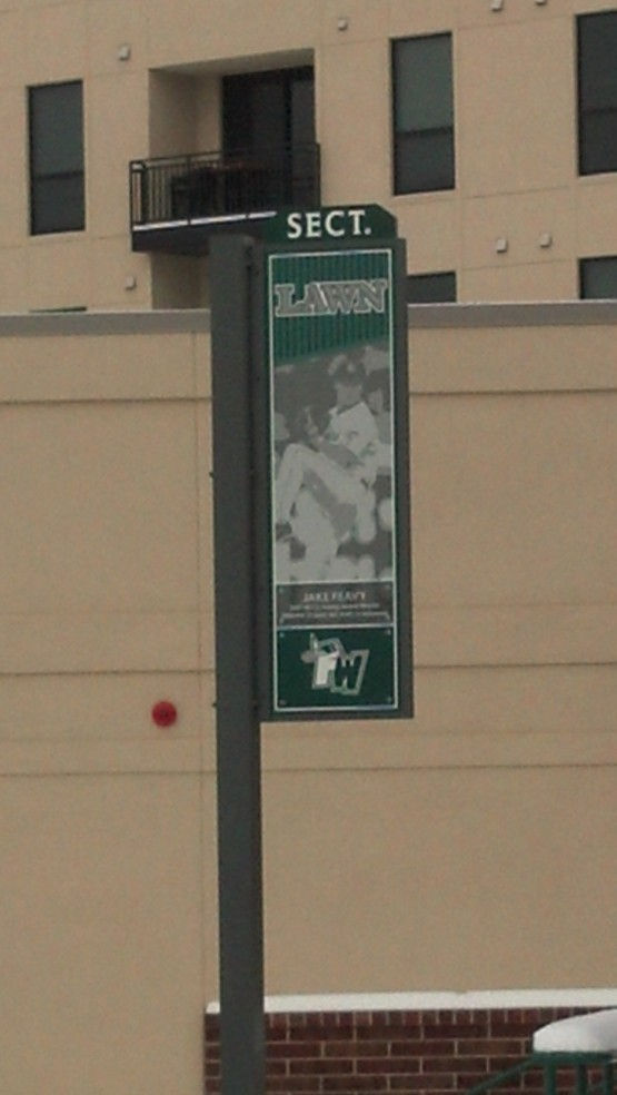 This Jake Peavy sign, one of many that display pieces of Fort Wayne's baseball history at Parkview Field, hangs beyond the center field wall.