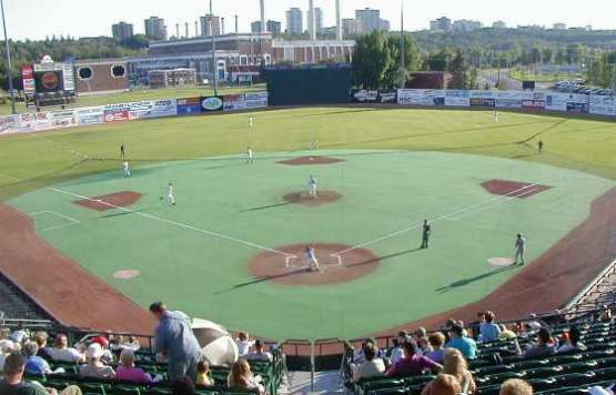 TELUS Field, featuring a turf infield and a natural grass outfield. (Photo from charliesballparks.com)