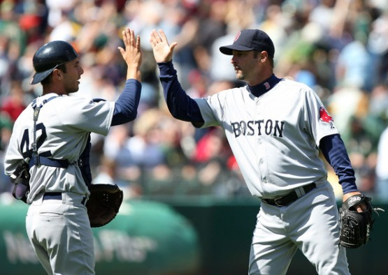 Former Wizard George Kottaras celebrates a Red Sox win with Tim Wakefield.